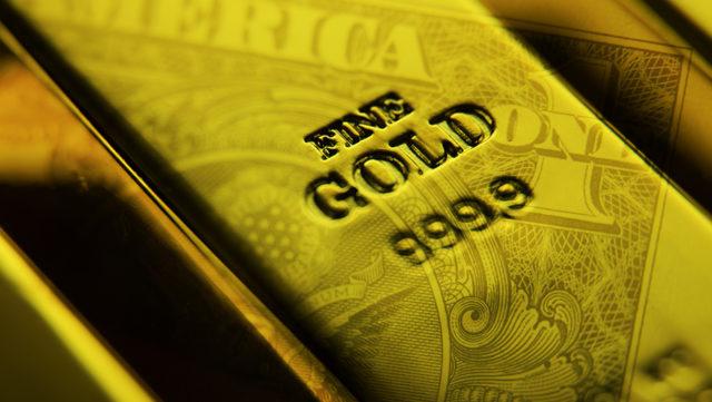 gold bar with dollar overlay
