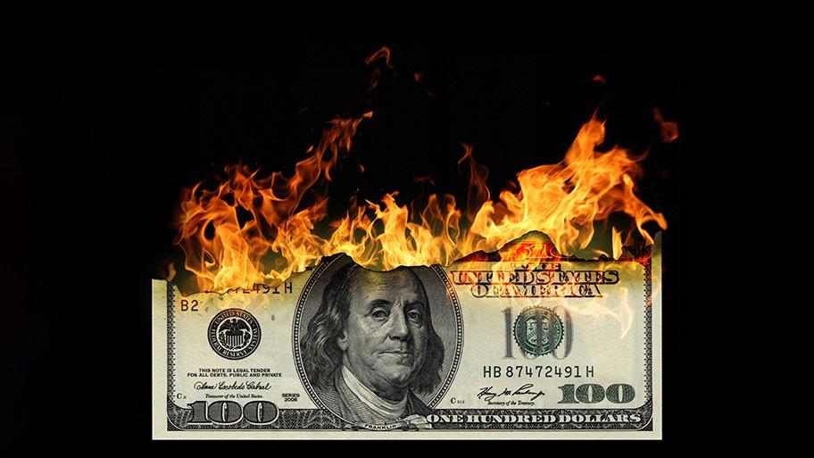 US dollar bill burning