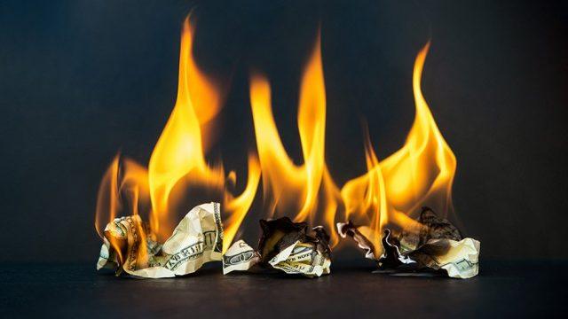 burning dollars - infrastructure bill