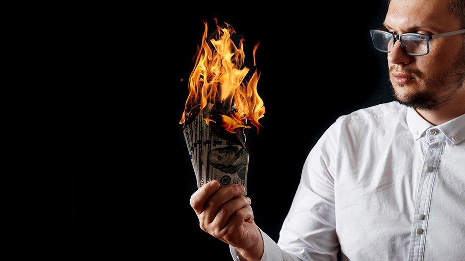 dollars burning