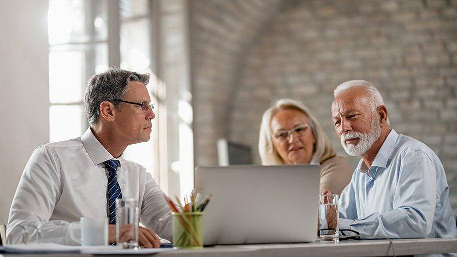 financial advisor with an elderly couple