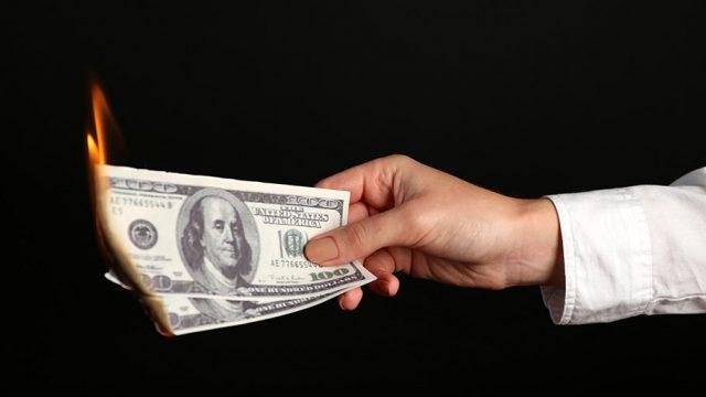 burning US dollars